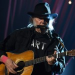 LOS ANGELES, CA - FEBRUARY 06:  Musician Neil Young performs onstage at the 25th anniversary MusiCares 2015 Person Of The Year Gala honoring Bob Dylan at the Los Angeles Convention Center on February 6, 2015 in Los Angeles, California. The annual benefit raises critical funds for MusiCares' Emergency Financial Assistance and Addiction Recovery programs. For more information visit musicares.org.  (Photo by Larry Busacca/Getty Images for NARAS)