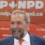 NDP Leader Tom Mulcair smiles while campaigning  in Stratford, Ont., on Wednesday, August 26, 2015. THE CANADIAN PRESS/Frank Gunn