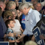 Conservative Leader Stephen Harper greets a young supporter as he arrives at a rally,  Monday, September 21, 2015  in Peterborough ON..THE CANADIAN PRESS/Ryan Remiorz