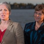 Catherine McKenna, left, Minister of Environment and Climate Change, speaks as British Columbia Premier Christy Clark listens after the federal government announced approval of the Pacific NorthWest LNG project, at the Sea Island Coast Guard Base, in Richmond, B.C., on Tuesday September 27, 2016. THE CANADIAN PRESS/Darryl Dyck ORG XMIT: VCRD134