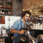 Shot of a young barista preparing a cup of coffee at a cafehttp://195.154.178.81/DATA/i_collage/pu/shoots/806208.jpg